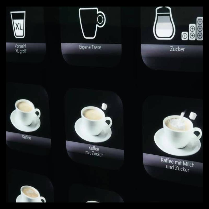 Tasten eines Kaffeeautomt fuer die Produktion